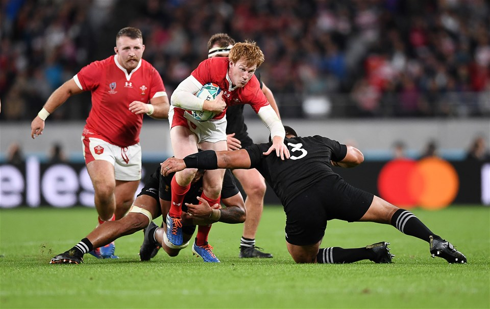01.11.19 - New Zealand v Wales - Rugby World Cup Bronze Final - Rhys Patchell of Wales is tackled by Shannon Frizell and Nepo Laulala of New Zealand.
