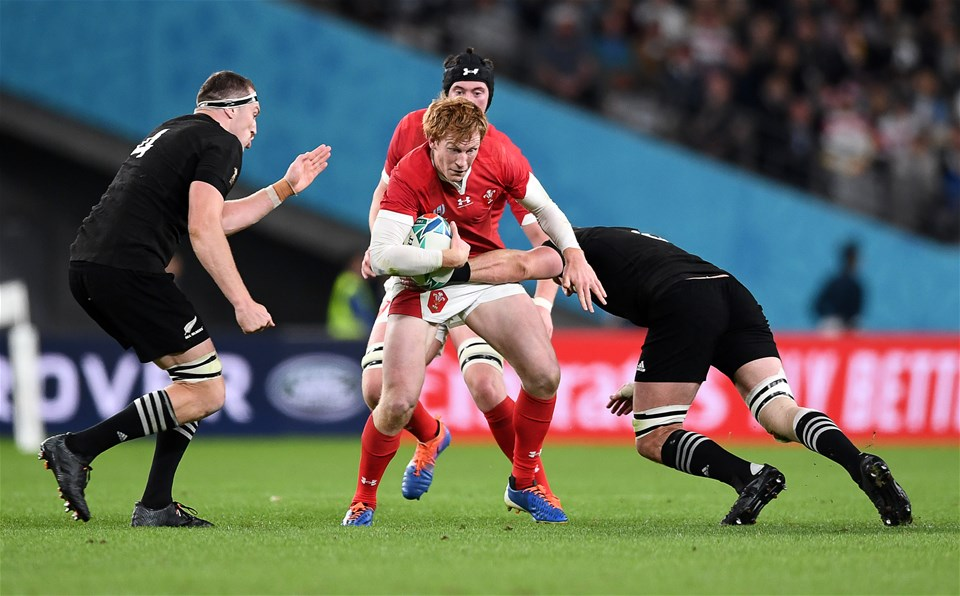 01.11.19 - New Zealand v Wales - Rugby World Cup Bronze Final - Rhys Patchell of Wales is tackled by Brodie Retallick and Kieran Read of New Zealand.