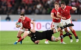 01.11.19 - New Zealand v Wales - Rugby World Cup Bronze Final - Josh Adams of Wales is tackled by Kieran Read of New Zealand.