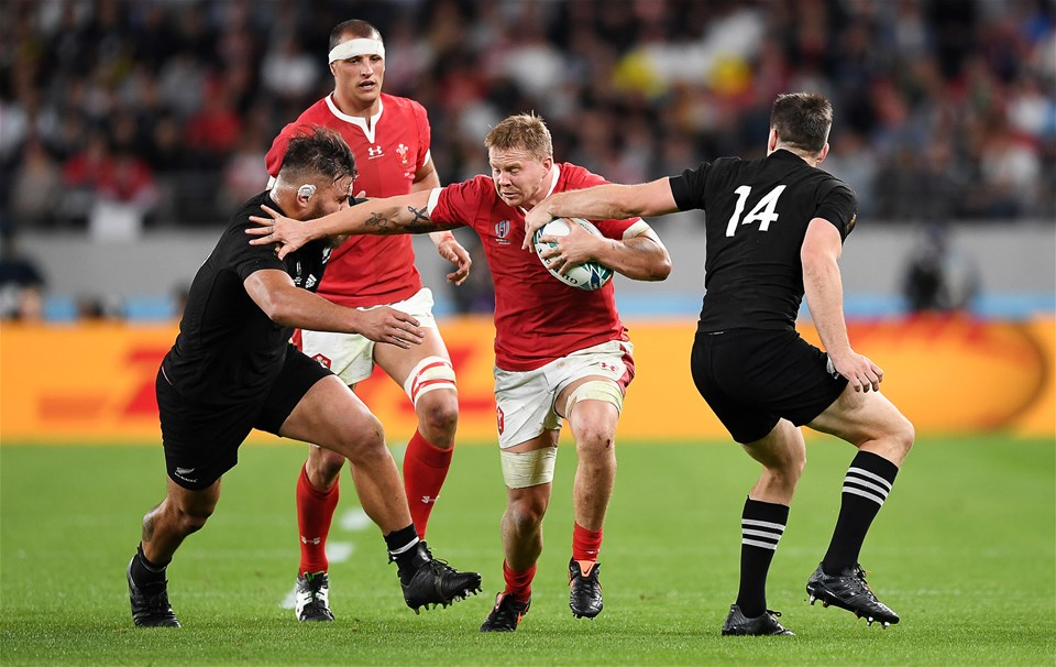 01.11.19 - New Zealand v Wales - Rugby World Cup Bronze Final - James Davies of Wales is tackled by Angus TaÕavao and Ben Smith of New Zealand.