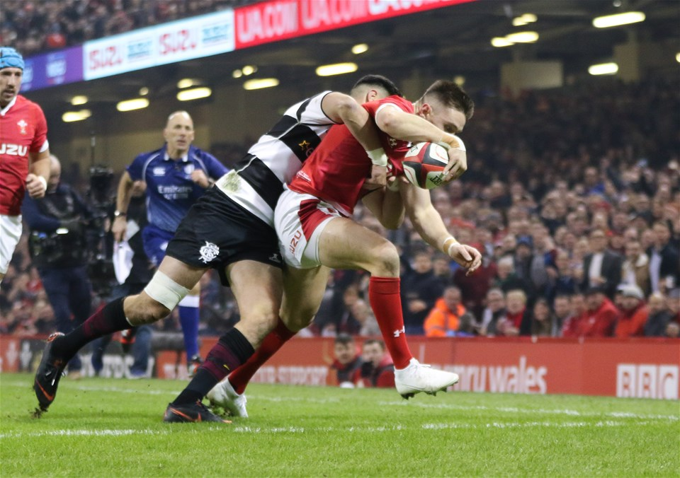 30.11.19 - Wales v Barbarians, Principality Stadium - Josh Adams of Wales beats Shaun Stevenson of Barbarians as he reaches out to score try