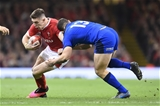 01.02.20 - Wales v Italy - Guinness Six Nations - Josh Adams of Wales is tackled by Luca Morisi of Italy