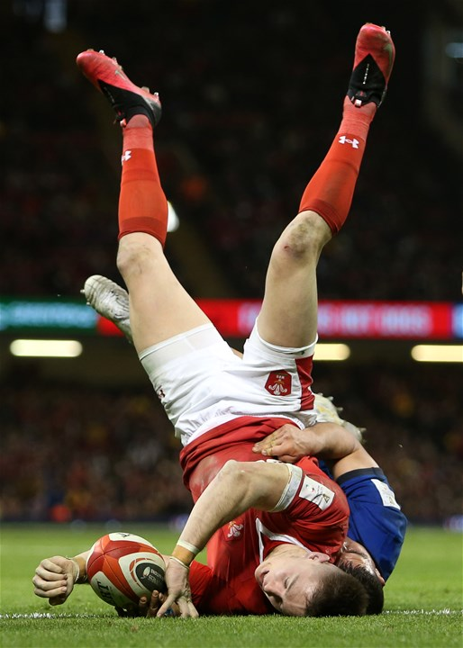 01.02.20 - Wales v Italy - Guinness 6 Nations - Josh Adams of Wales is upside down as he scores a try at the end of the game.