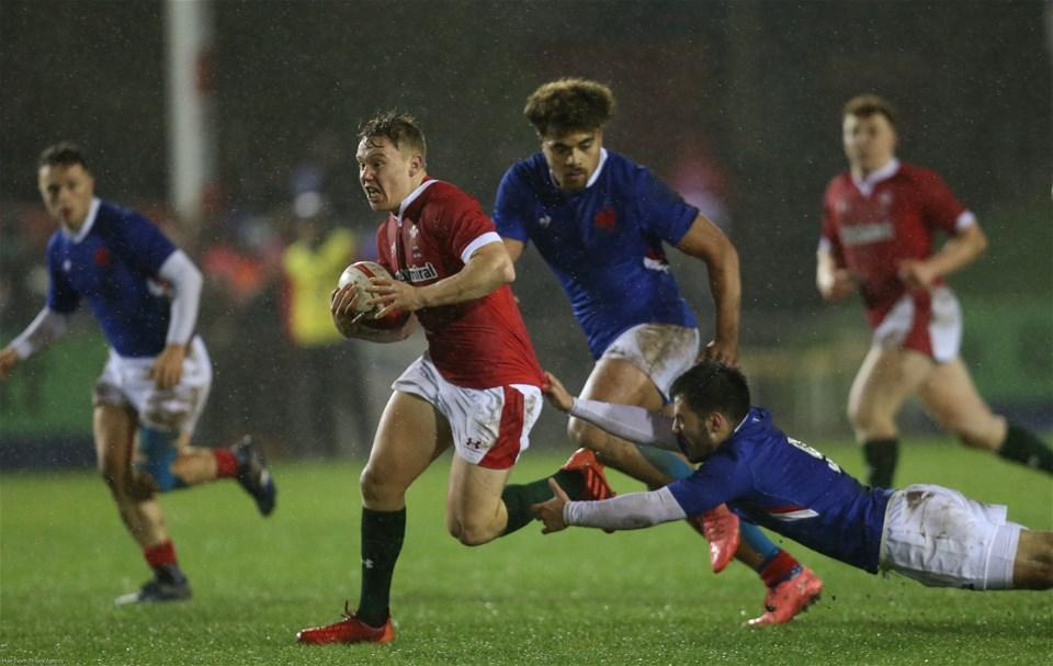 21.02.20 - Wales U20 v France U20, U20 Six Nations Championship - Sam Costelow of Wales holds off Kevin Viallard of France
