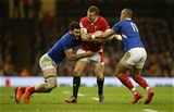 22.02.20 - Wales v France - Guinness 6 Nations - Hadleigh Parkes of Wales is tackled by Charles Ollivon and Gael Fickou of France.
