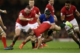 22.02.20 - Wales v France - Guinness 6 Nations - Gareth Davies of Wales is tackled by Gregory Alldritt of France.